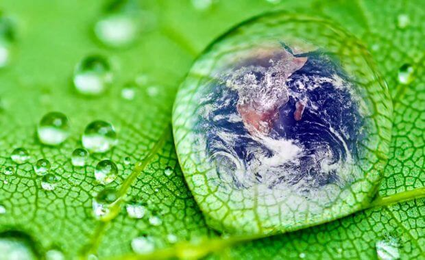 a drawing of the earth inside of a water drop representing cleanliness