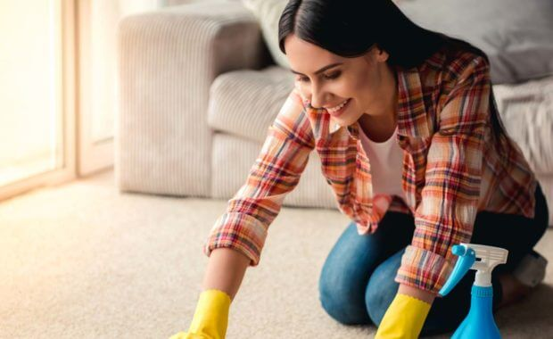 a woman keeping her carpet clean