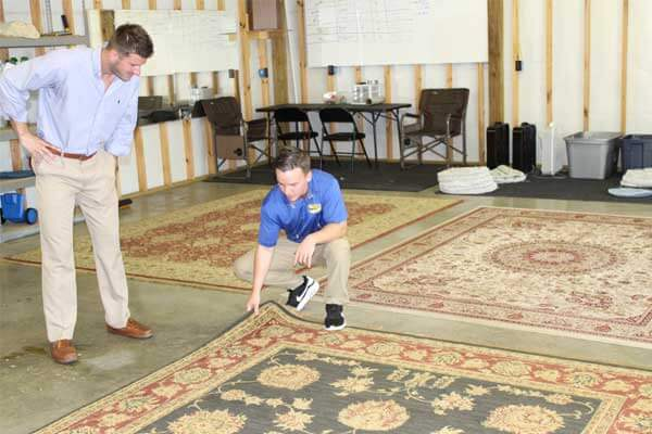 Client being shown safedry method for cleaning carpets