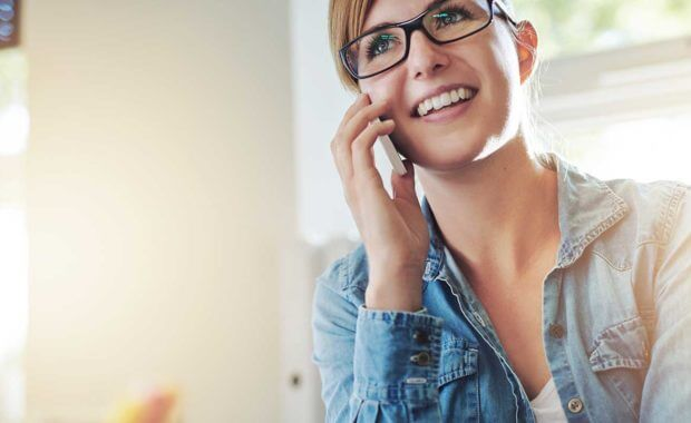 woman on phone trying to find the best carpet cleaning service