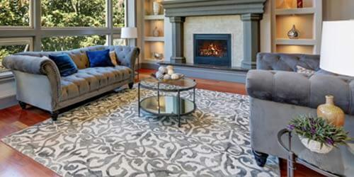 beautiful area rug in living room of home