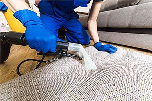 professional using a carpet cleaner in a residential home