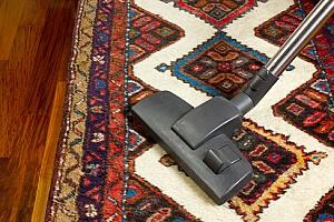 Vacuuming Oriental Rug