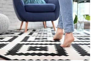 Woman walking barefoot on carpet