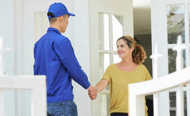 Greeting professional carpet cleaner at door