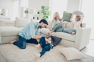 a family spending time together on their living room carpet