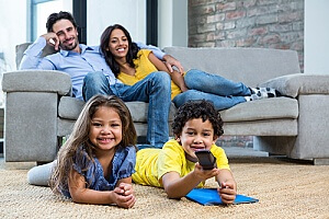 family enjoying their newly cleaned and sanitized carpet