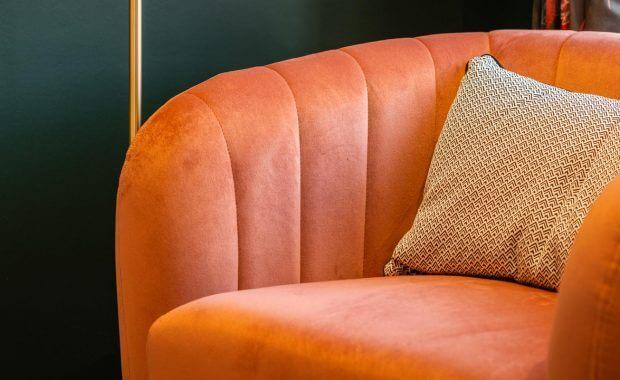 Clean upholstery on orange armchair